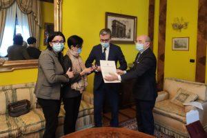 Consegna Medaglia d'Oro familiari Don Roberto Malgesini