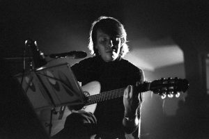 the poet and singer-songwriter Fabrizio De Andrè in concert, Milan (Italy), 1976